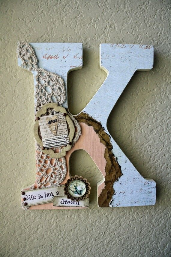 """Large Nursery Wall or Table Monogram Letters by LolaMonkey on Etsy  Measuring in at 8 3/4"""" high and 5 1/2"""" wide, this chunky block letter comes decorated and personalized to match your color scheme. Ready to hang on the wall using the pre-cut notch, or you can stand it up on a table, shelf, bookcase, etc."""