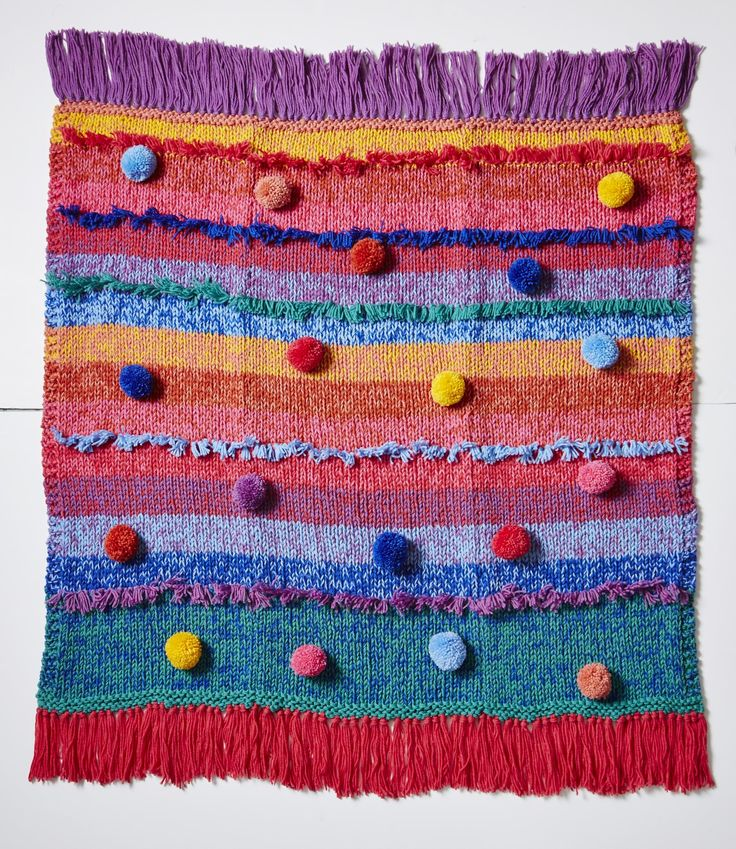 Ever wondered what a 'Boho Chic' throw rug with optional tassels and pom-poms looks like? You're looking at it.  Knit or crochet yourself with any one of the kits available over on BHGSHOP.com.au.  Comes in wool or acrylic.