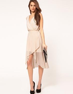 A simple cream chiffon wrap front dress. I like the flowing lines, wide sleeves, and drape hi/low hem: Midi Dresses, Chiffon Dress Church, Dressy Tressy, Cute Bridesmaid Dresses, Chiffon Dresses, Grey Dresses, Dress Church Ceremony