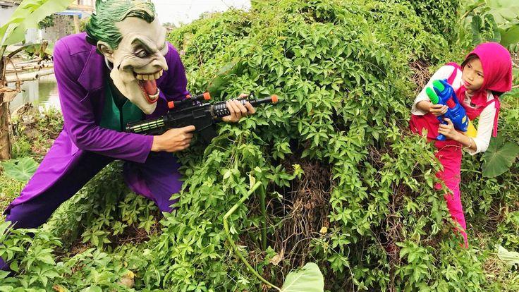 Nerf War Superhero shooting war Spiderman Joker Frozen Elsa Funny Videos...