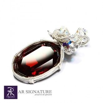 Elixir, Genuine Swarovski® crystals pendant by AR Signature. Fully handcrafted with Genuine Swarovski Crystal and Plated wire from USA and coated with AR Signature protective coating.  The deep red color really bring out the personality.  Color: Red Magma