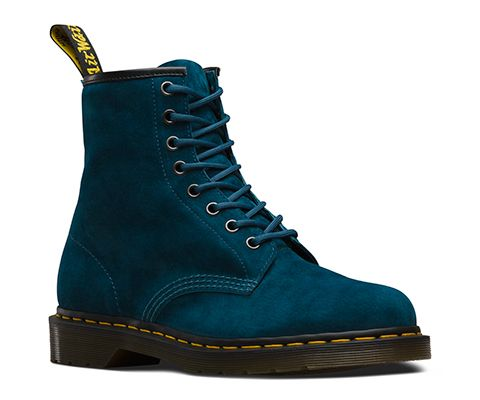 The first revolution happened in April 1960. That's when the original Dr. Martens 1460 8-eye boot rolled off the production line in Northamptonshire. Designed with a unique performance technology—air cushioned soles—the boot brought a new level of comfort to England's working class. This season, the classic unisex boot is updated in a new leather: Soft Buck, a genuine pigskin Nubuck with a very soft feel. The 1460 unisex boot has all the classic Doc DNA, like yellow stitching, grooved…