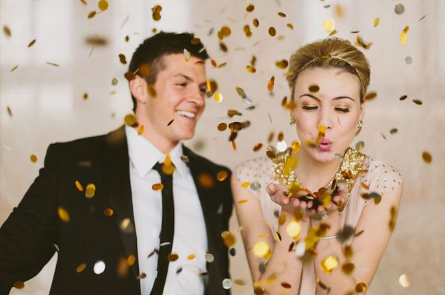 Sparkles in a new years wedding with gold confetti! What an adorable couple in black tie attire.
