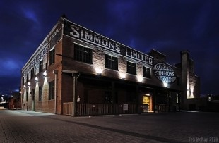 Old Simmons factory warehouse, built in 1912. It's in front of the RiverWalk Plaza, east of down town.