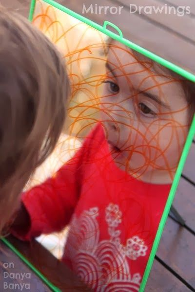 """Invite your child to draw on a mirror, and you might catch a glimpse of how they see themselves..."" ~ Danya Banya Mirror drawings - an easy preschooler art activity that they can do again, and again, and again..."