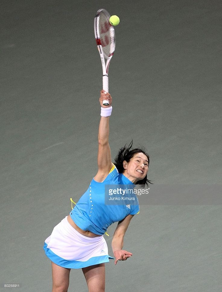 Kimiko Date serves during an exhibition match against Steffi Graf during the 2008 Dream Match at Ariake Colosseum on March 15, 2008 in Tokyo, Japan.