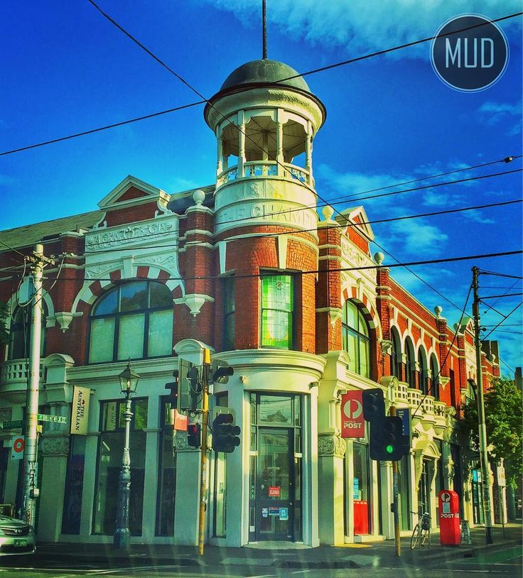 The former Champion Hotel in Fitzroy. Where illegal gambling took place at the turn of the century barmen got shot and safes got stolen. A typical Fitzroy pub. Well typical before now it's home to a post office.... #melbourneuberdriver #pub #building #city