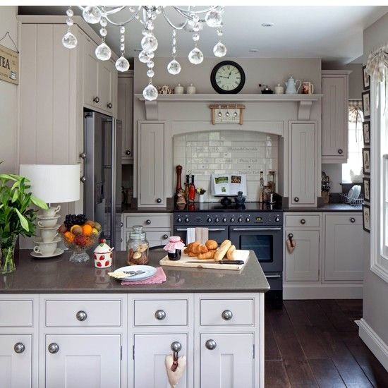 Go for a traditional look in the kitchen with smart cabinets and a classic chandelier. A range cooker adds warmth to the scheme.