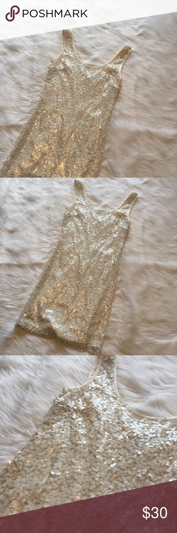 🆕 White House Black Market Cream Sequin Dress White House Black Market Cream Sequin Dress. Excellent used condition - no flaws! Sequins all intact. **Smoke free home. Ask questions. Bundle to save both on shipping and total price. Serious and reasonable offers only (no more than 10% of listing price). Not interested in trades ATM. Sharing is caring!** White House Black Market Dresses Mini