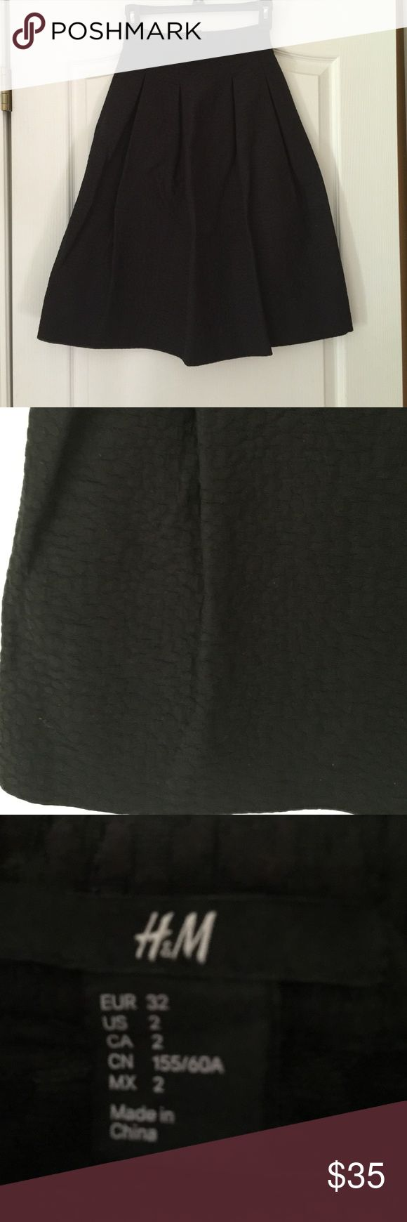 H&M black midi skirt. Size 2. H&M black midi skirt. Size 2. Very comfortable! Great condition! H&M Skirts Midi