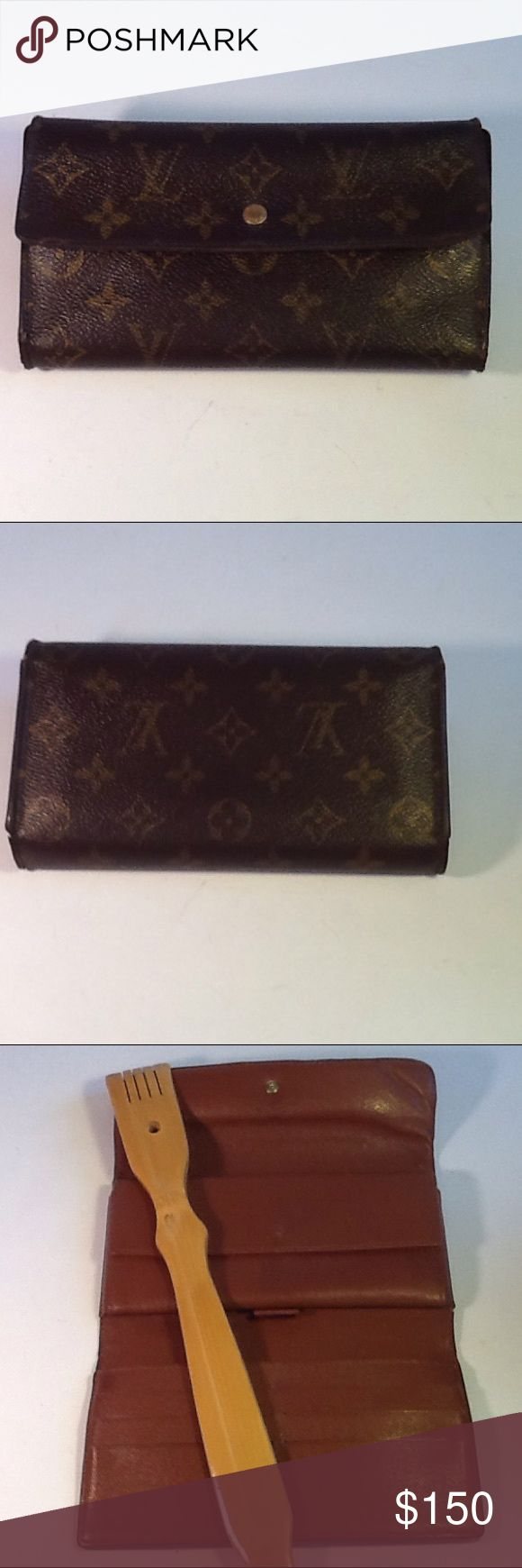 Authentic Louis Vuitton Long International Wallet. The inside leather gas some curling due to folding. The leather showed signs of used. The canvas us good. The wallet was made in France with a date code TH 0953. Louis Vuitton Accessories