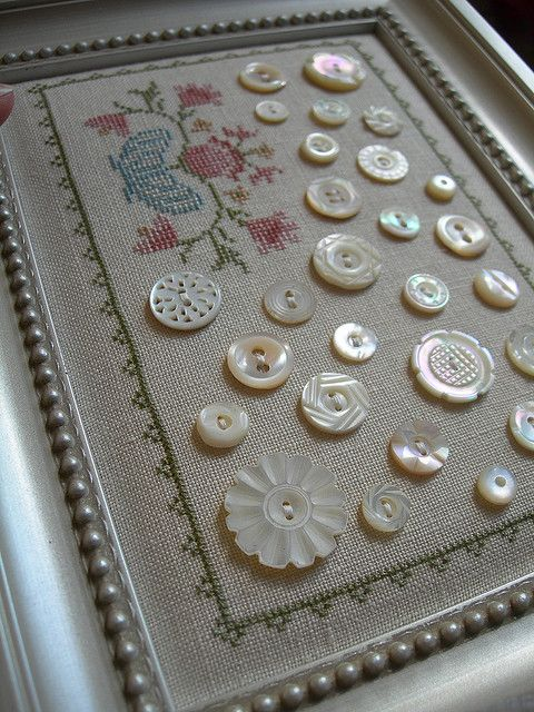 This is absolutely lovely!  Mother of pearl buttons attached to embroidered linen.
