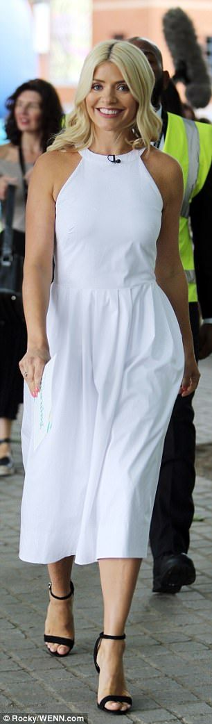 Simply stylish: Followers said the This Morning presenter, 36, looked 'absolutely stunning' as she posed in a chic backless ivory dress with a demure midi length