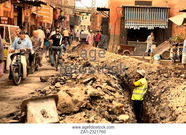 MARRAKESH, MOROCCO - OCTOBER 18: Unidentified Man calls from a trench of the narrow Streets Of The Medina on October 18th, 2011 in Marrakesh, Morocco
