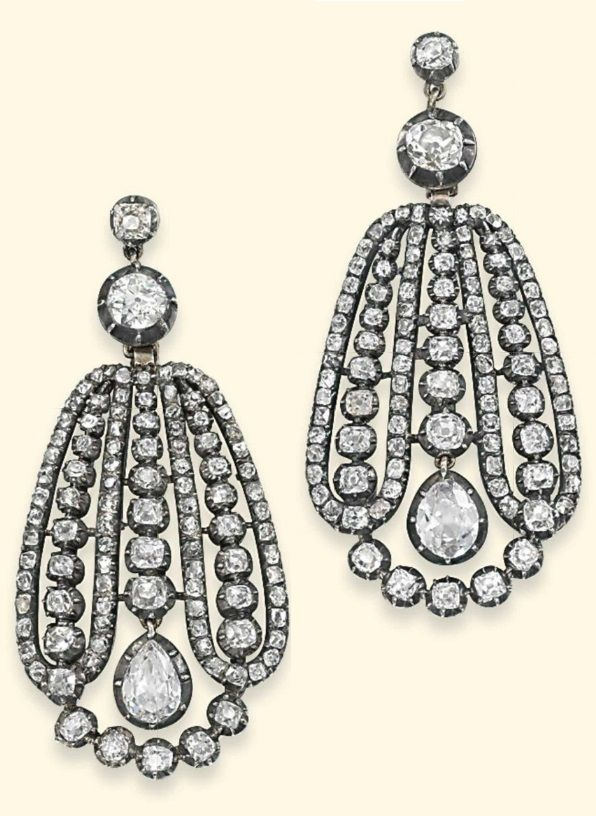 A PAIR OF GEORGIAN DIAMOND EAR PENDANTS, CIRCA 1810. Of broad, drop shaped design, each with a central graduated line of old-cut diamonds to an articulated pear shaped diamond drop, within a triple diamond line loop frame surround, suspended from a twin diamond collet surmount, partially closed-set, mounted in silver and gold, 5.5cm long. #Georgian #antique #earrings
