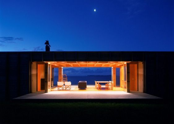 When the timber walls of the house can be lowered to open up the house to the view. They also create large decks front ...