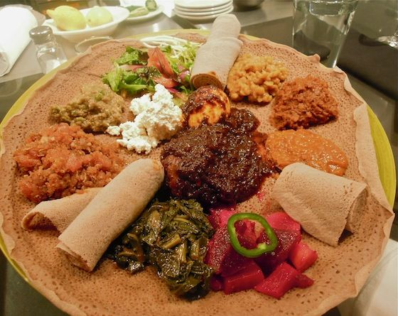 Platter of Ethiopian dishes served on injera. Read Anna Mindess' BAB post: Ancient Ethiopian Cuisine Honored with a Limited Run At Guest Chef