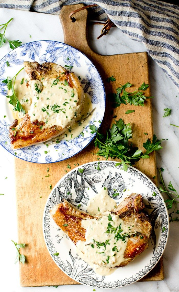 Delicious recipe for juicy pork chops with mustard cream sauce. A perfect pairing of flavors for this delicious cut of meat.