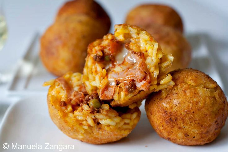 My family recipe for a very popular Sicilian street food: arancine - fried balls of saffron rice filled with either a meat or a cheese sauce.