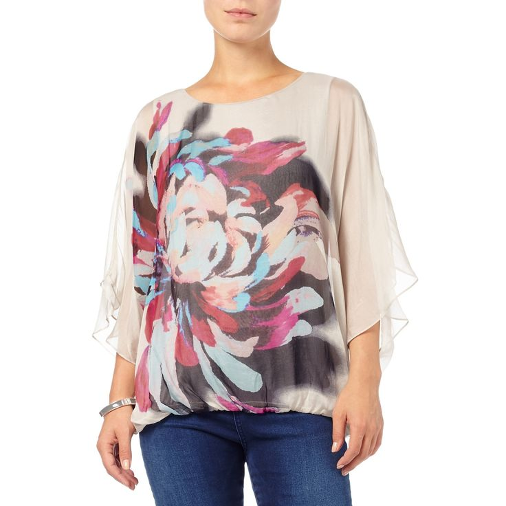 This top features an overlay of floaty silk, with batwing sleeves, a banded hem for a blouson fit and a bright peony placement print. Includes a sleeveless jersey lining for comfort.