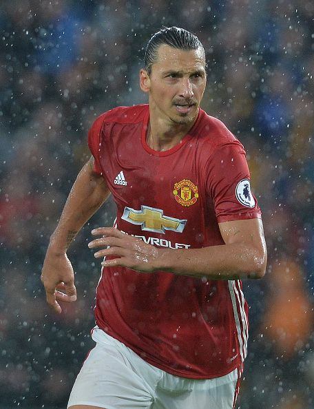 Zlatan Ibrahimovic of Manchester United challenges with Jake Livermore of Hull City during the Premier League match between Manchester United FC and...