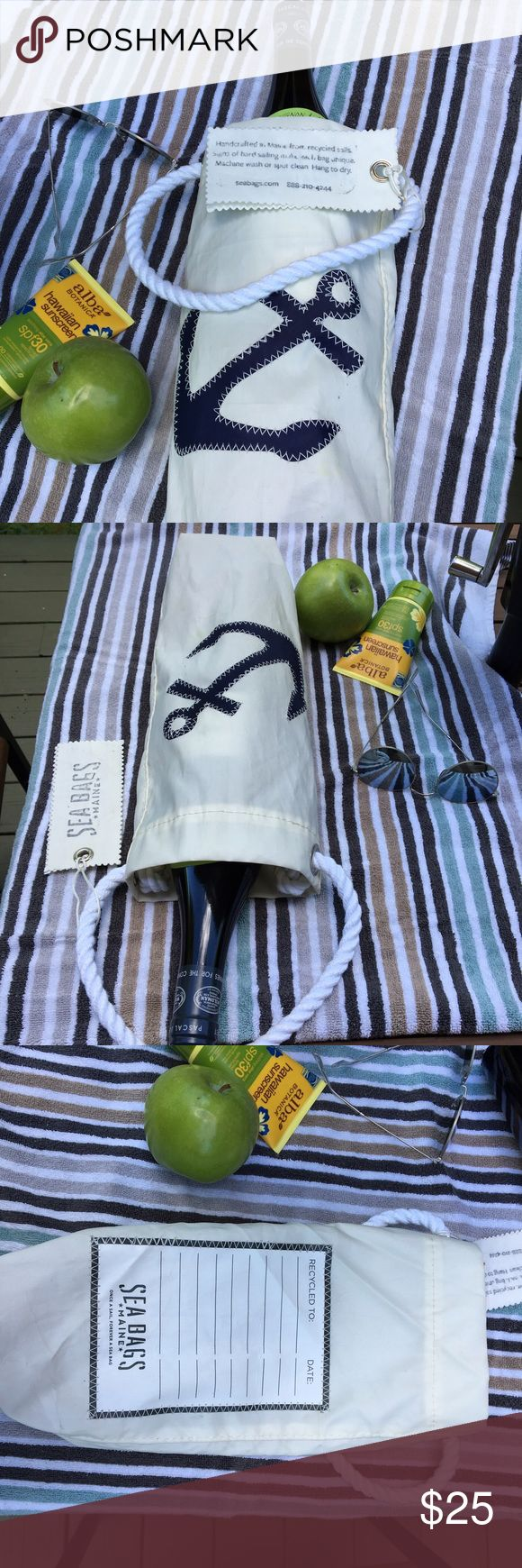 Sea Bags Anchor Wine Bag MWT Price FIRM Handcrafted from recycled sails on the working waterfront in Portland, Maine, the Anchor Wine Bag is all you need to start your adventure. Designed to give over and over, there's a travel log on the back. The blue stitched Anchor is a classic symbol of the recycled sail bags. Retail $35, with a hand-splice rope handle, machine wash, line dry. Imperfections are part of the charm of this bag. Literally crafted from a recycled sailboat sail, take a piece…