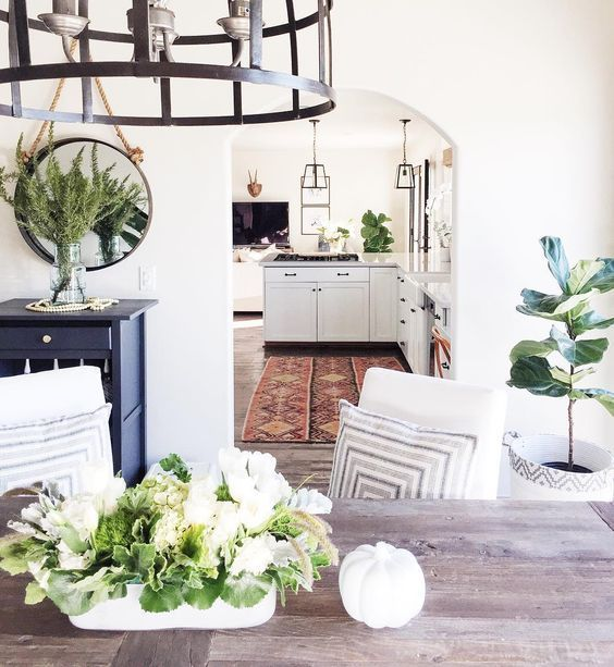 Decorating with greenery, the Pantone 2017 color of the year. Click to read our design tips for incorporating this trend into your home decor!  Hadley Court Interior Design blog  #diningrooms #interiordesign