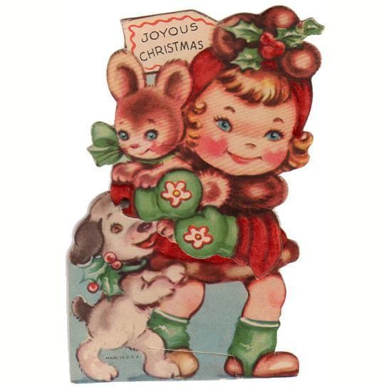 Vintage 1940s Mechanical Christmas card. Little girl dressed in red, holding a bunny. With a dog near her feet. Red hat and coat on girl are flocked. Girl is jointed at the waist so she can bend back