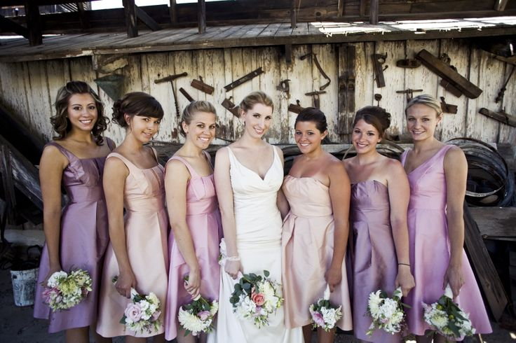 One of our favorite wedding color palettes of all time!  Soft Pink, Peach and Greyed Lavender.