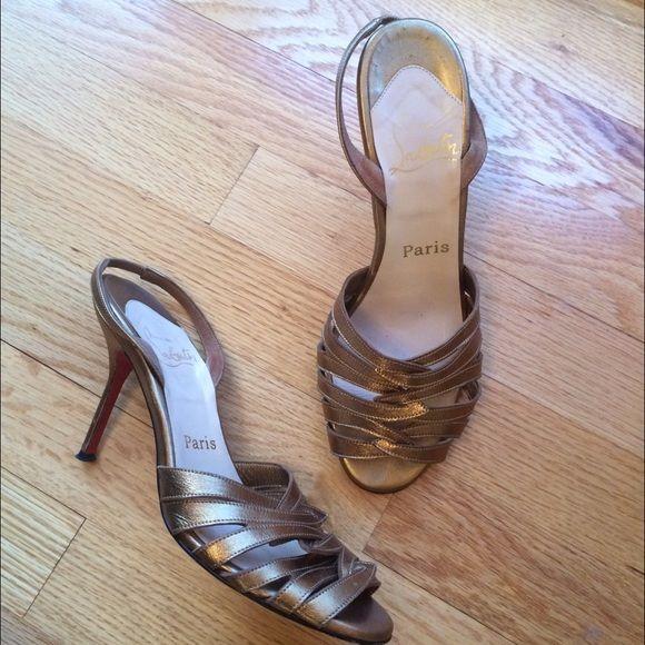 Christian Louboutin Gold Sandals Heels Authentic Christian Louboutin gold strapped heels. Size 37. Open toe mules. Fits 7-7.5 Christian Louboutin Shoes Heels