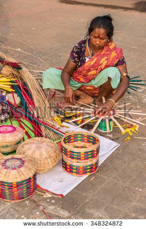 KOLKATA, INDIA - NOVEMBER 24: An Indian craftswoman weaves cane baskets for sale during the annual State Handicrafts Expo 2015 on November 24, 2015 in Kolkata, West Bengal, India.