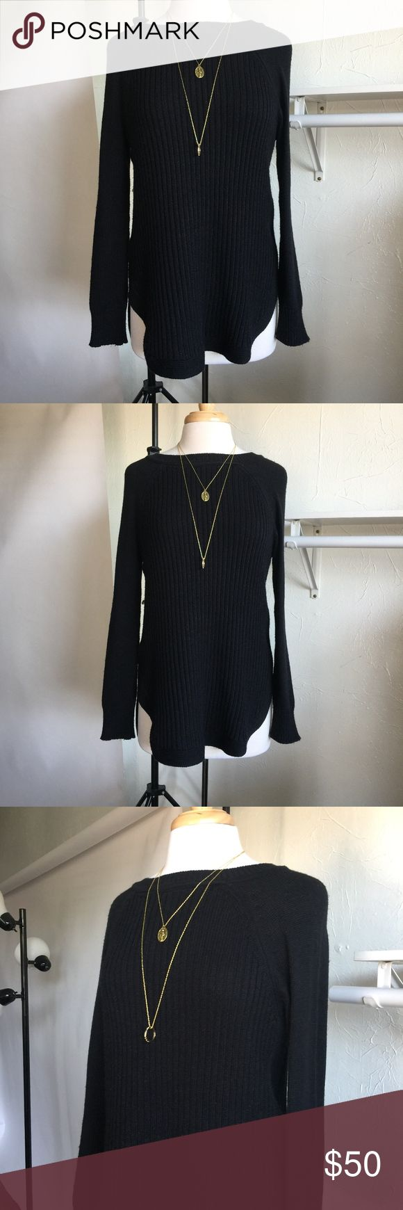 Black Knit Sweater Black knit sweater with a short long design at bottom. Perfect for the winter, can be paired with any bottoms. Marked as medium, will fit oversized on petites. Be sure to find me on Instagram @theanalyssa and Snapchat the.analyssa  Measurements: -Sleeve length: 27 in. -Back of neck to bottom of hem: 30 in. -Width laying flat: 17 in. -Marked as Medium -Care: Hand wash cold Sweaters