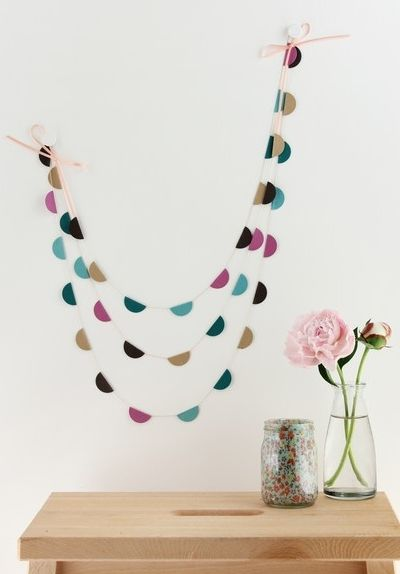 Use a swagged garland to cover a big wall