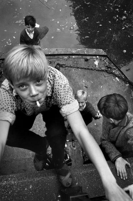 Kids smoking at a canal