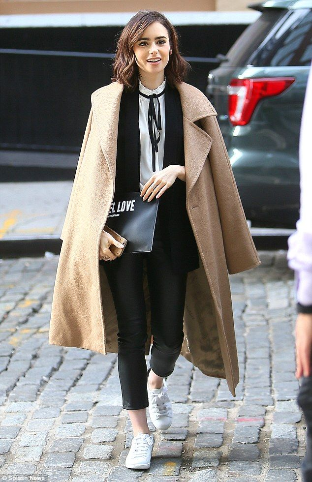 Casual chic: On Thursday Lily Collins enjoyed a well-deserved break from dressing up, in a more casual ensemble