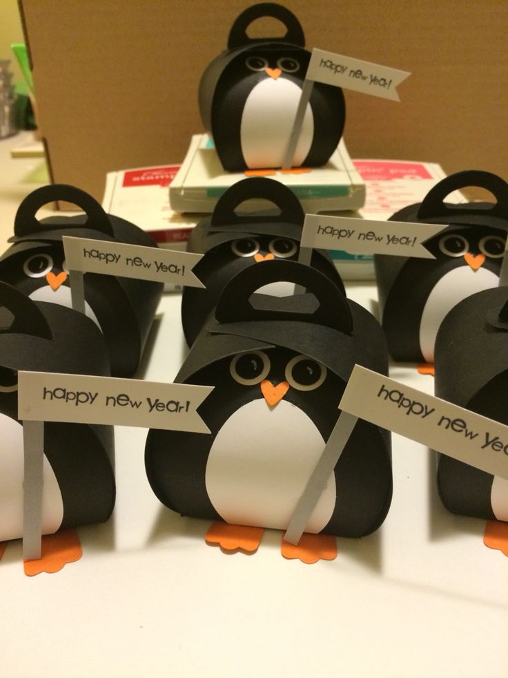 A penguin parade made with the Stampin' Up! Curvey keepsake box and punches. They make me and the girls in my stamp club smile on this very cold January day.