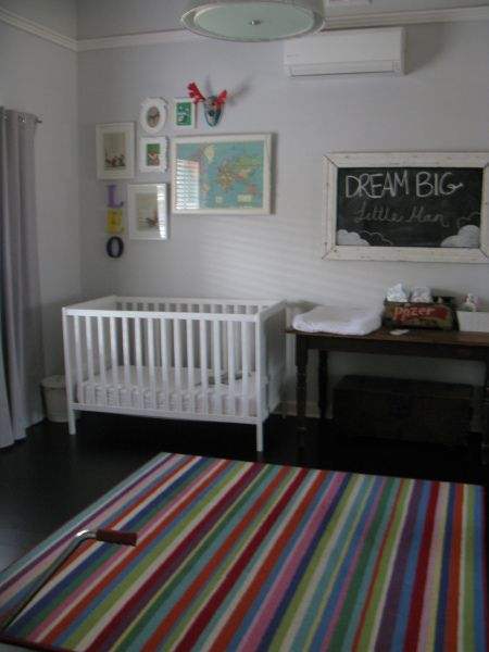 A beautiful reno in Mt Lawley and saying 'no to a red feature wall' | the traveller's return baby room with rug, blackboard and table for changetable