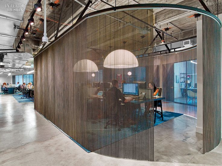 WME/IMG's Office by the Rockwell Group Lets Talent Shine | A steel-bead curtain delineates an office area. #design #interiordesign #interiordesignmagazine #offices #NewYork #NYC