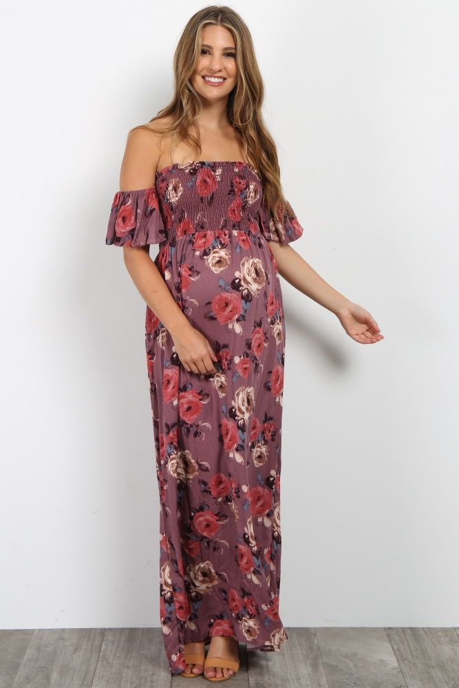 We are in love with this gorgeous off shoulder maternity maxi dress! A smocked bust and chic boho style give this maternity maxi dress a stylish look. With a lightweight material and flowy feel, you won't want to take this dress off. Pair this maternity dress with a neutral sandals and a choker for a trendy look.