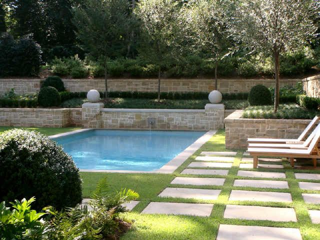 Pool with no decking, only grass and coping stone around pool,,grass!