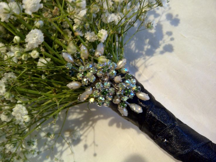 Vintage brooch finishes the look