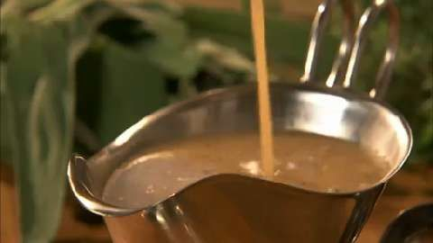 Making Turkey Gravy | See how to make perfect turkey gravy for Thanksgiving dinner.