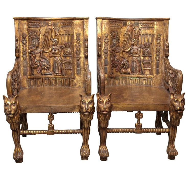 Pair of Egyptian Revival Giltwood Throne Chairs. Art Deco era chairs were inspired by the throne chairs found in King Tutankhamun's tomb. Giltwood with detailed carving ca.1925