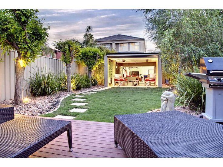 Exterior,Amazing Backyard Design Ideas With Green Grass Garden And Black  Wicker Lounge Chairs Feat Modern Rotisserie For Outdoor Kitchen,Wonderful  Backyard ...