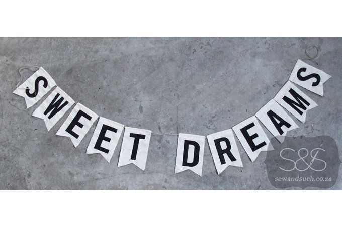 """Sweet dreams"" message bunting, perfect for a nursery or kid's room.Each flag measures 10x15cm."