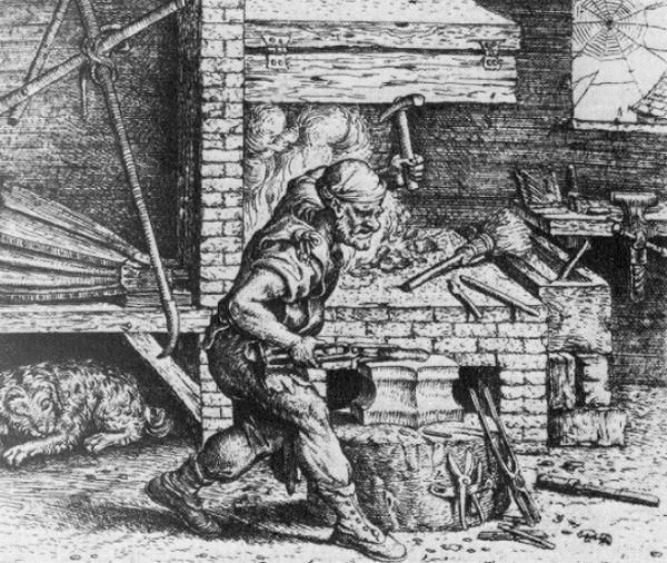 A realistic impression of a smith at work from sometime in the 1500's, from a Flemish woodcut. The pentagonal anvil is still present, as are some bellows, a long quenching trough, a leg vice and rather bizarre lion faced dog under the bellows table.