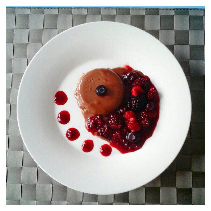 Chocolate panna cotta with mixed berry sauce