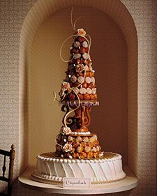 croquembouche = traditional wedding cake of France. so cute! what if the cream puffs were replaced with andagi (Okinawan doughnuts)? {photo: martha stewarts wedding}