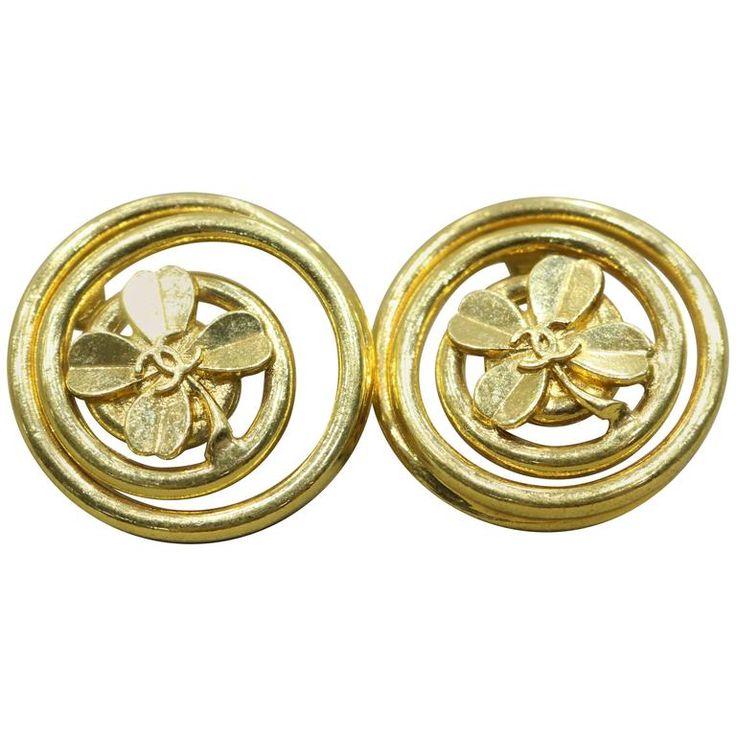 Chanel Vintage Gold Toned Clover Swirled Edge Clip On Logo Earrings  1950