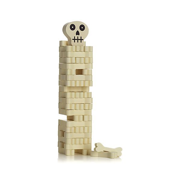 Stack the bones if you dare. Fun stacking Halloween game challenges you to remove a bone from the bottom and restack it on top without toppling over the tower. Includes painted wood blocks shaped like bones, instructions and a cute skull to set on top of the stack.